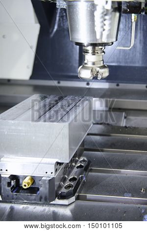 The face milling tool with the raw material work piece on the CNC milling machine.