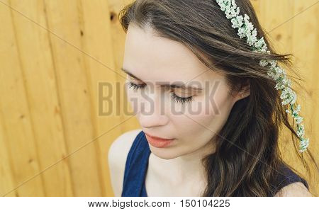 flowers branches spirea on a head young woman
