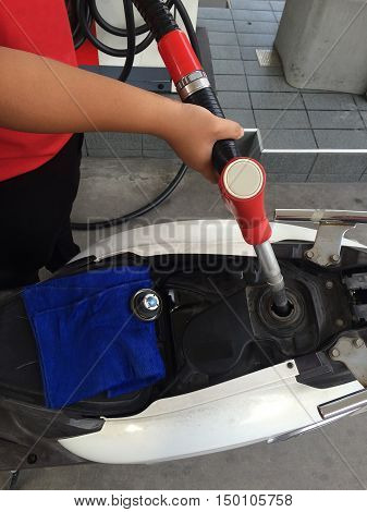 Gasoline pump station and services, Oil refill.