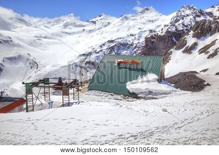 CAUCASUS RUSSIA - May 01.2015: Covered by snow on the roof alpine hotel on the hillside of mountain Elbrus