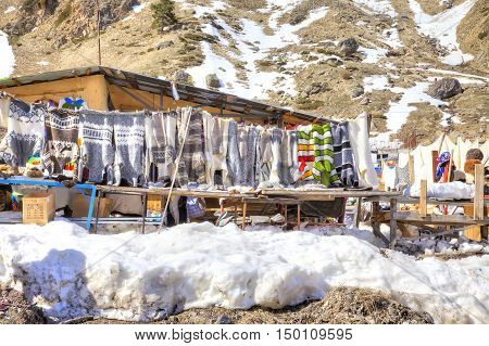 CAUCASUS RUSSIA - May 01.2015: Sale of warm things on the glade of Azau in the settlement of skiers at the foot of mountain Elbrus