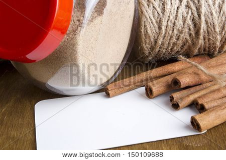 Cinnamon sticks and ground cinnamon on a wooden table