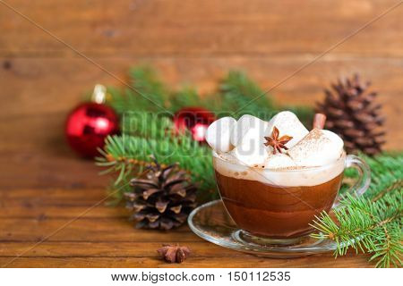 cup of hot cocoa with marshmallows on a Christmas background,