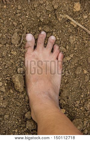close up dirty feet on the ground