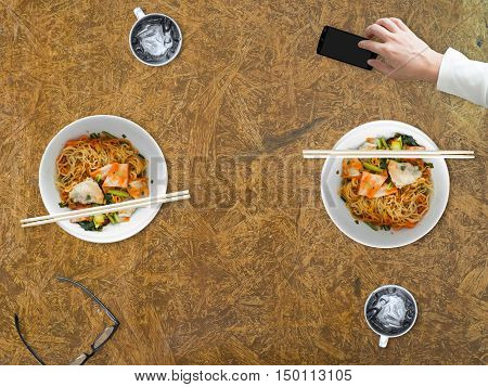Bad manner of using smartphone while eating with other people.