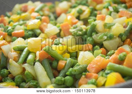 close up of colored vegetables stewed at the oriental style