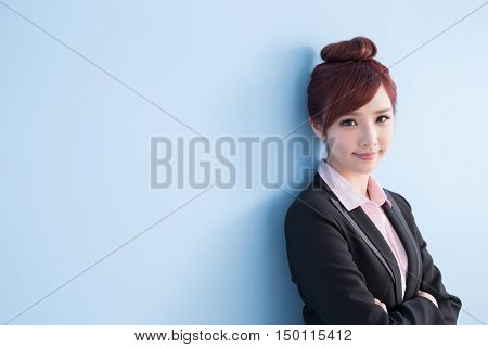 business woman is smile to you and cross arm isolated on blue background asian
