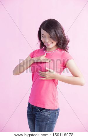 Happy Woman check her chest great for prevention breast cancer concept