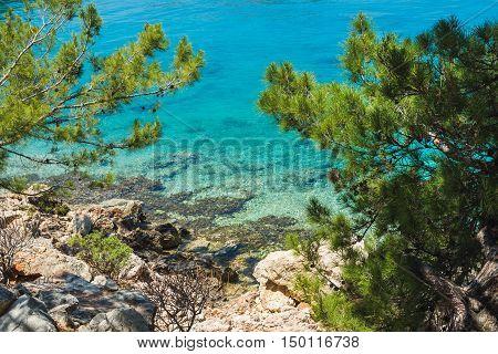 Mediterranean sea coast with clear sea water at Kastelorizo island on sunny day, Dodecanese, Greece