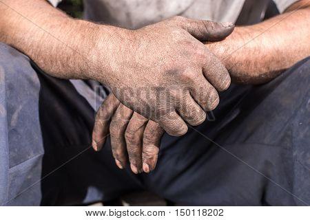 Worker Man with Dirty Hands. Charcoal-burners worker man with dirty hands.