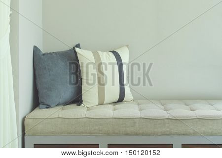 Pillows on comfy seat in living room