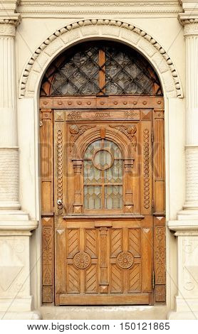 Wooden old doors on the wall .