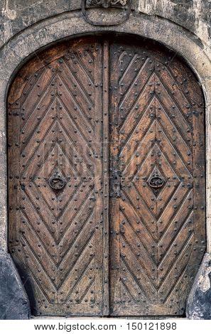 Texture of old stained wooden door .