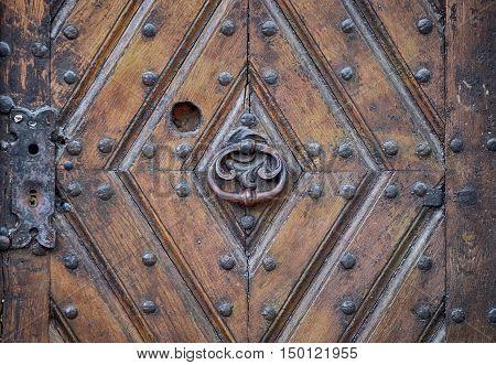 Iron Knocker On An Old Door