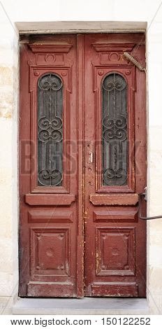 Old brown excellent wooden doors at the wall