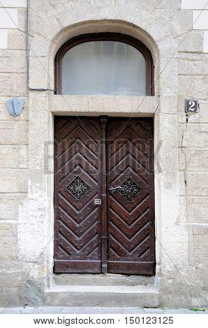 Old brown excellent wooden doors close up