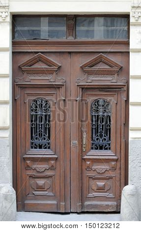 Old brown excellent wooden doors on the wall