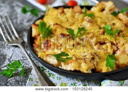 Frittata with cauliflower and mozzarella on a concrete background