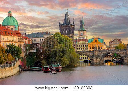 poster of Famous Prague Landmarks - towers and bridge at sundown time with beautiful sky, Prague, Czech, Europ
