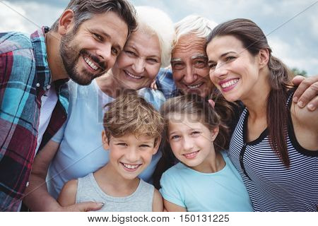 Portrait of happy multi-generation family standing outdoors