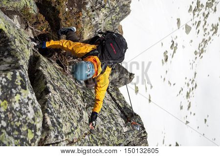Portrait of a climber on a Via Ferrata in Switzerland