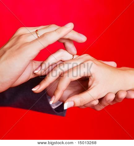 Hands Of A Bride And A Groom