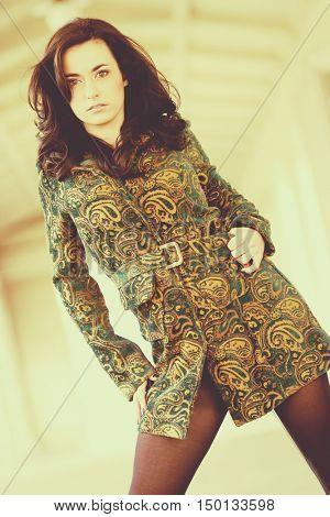Beautiful fashion model woman standing outside