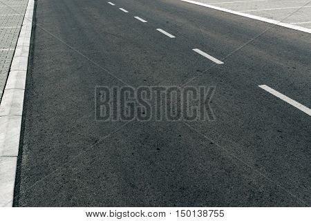 Empty two lane asphalt road highway vanishing in perspective