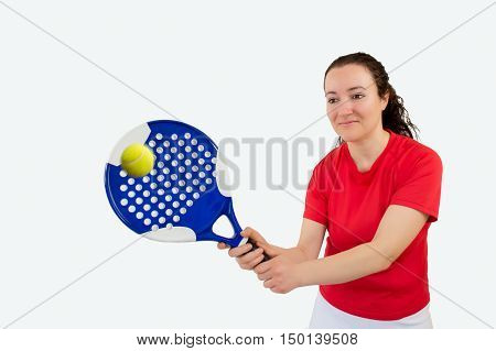 portrait of a girl paddle tennis player standing and swatting the ball