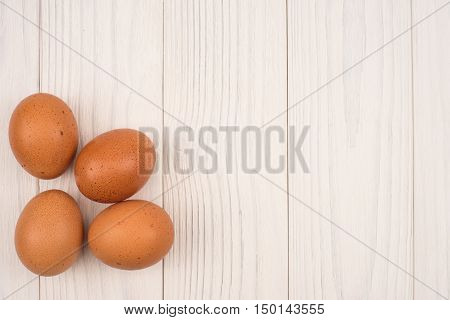 Beautiful chicken eggs on white old wooden table