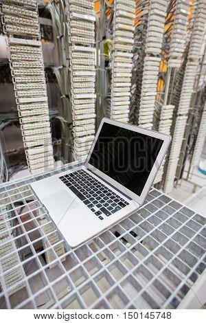 Laptop kept on rack in server room