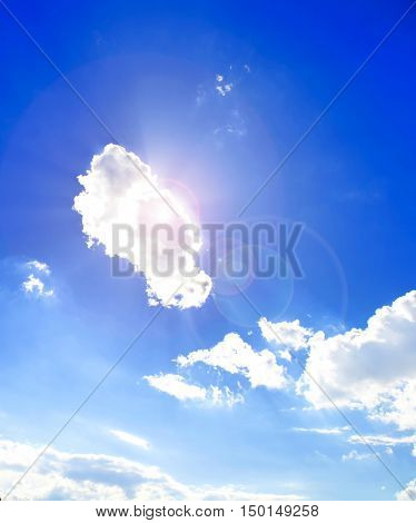 Wtite cloud in blue sky, isolated,stormy, atmosphere, windy, bright, swirling,
