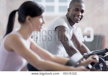 Couple Biking At Gym