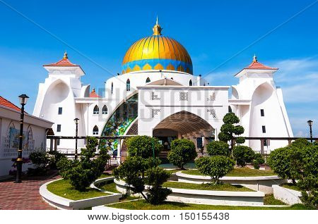 Malacca Straits Mosque Malaysia located in a man-made island. It is a relatively new and very colorful mosque