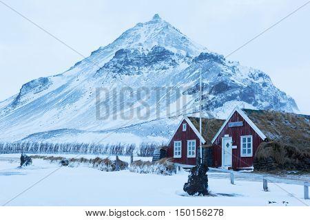 Icelandic turf houses in Arnarstapi. Arnarstapi or Stapi is a small fishing village, Snaefellsnes ,  Iceland.