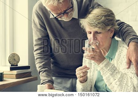 Senior Adult Taking Pills Medicine Concept