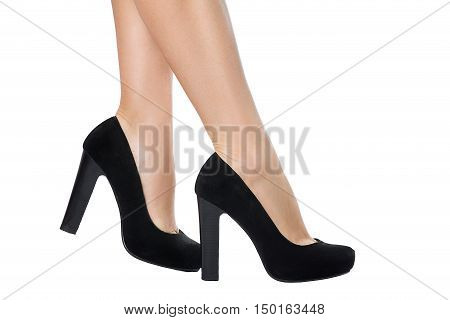 Woman legs in heels. Bare legs of the woman isolated on white. Beautiful skin. Foot care