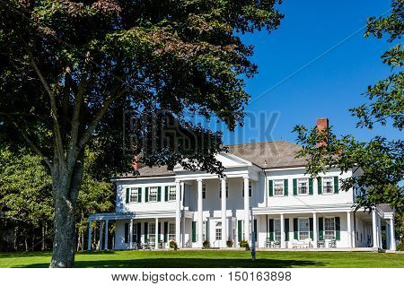 White Colonial with Green Shutters in Canada