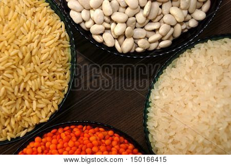 various cereals and legumes in bowls, Rice, Lentils,  barley noodles,haricot bean