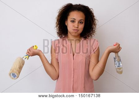 Tired Woman Painting The Wall Of Her House