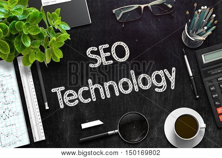 Top View of Office Desk with Stationery and Black Chalkboard with Business Concept - SEO Technology. 3d Rendering. Toned Image.