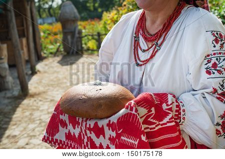 Traditional Eastern Slavic welcome with loaf of bread and salt in Ukraine