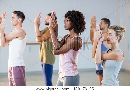 Group of people exercising in fitness studio