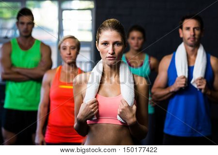 Portrait of serious young friends standing in gym