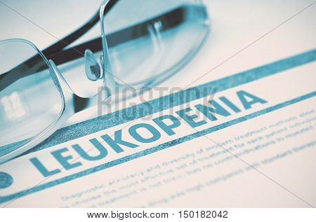 Leukopenia - Medical Concept with Blurred Text and Glasses on Blue Background. Selective Focus. 3D Rendering.