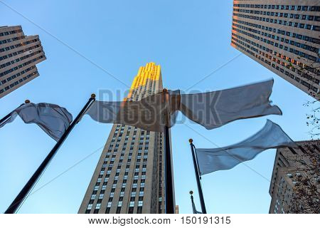 Top of The Rock, Famous Landmark - Rockefeller Center is a complex of 19 commercial buildings, located in Manhattan, with early morning sunlight. New York City, 19 of December 2015