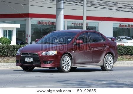 CHIANGMAI, THAILAND -FEBRUARY 29 2016: Private car, Mitsubishi Lancer. On Truck on road no.1001, 8 km from Chiangmai city.