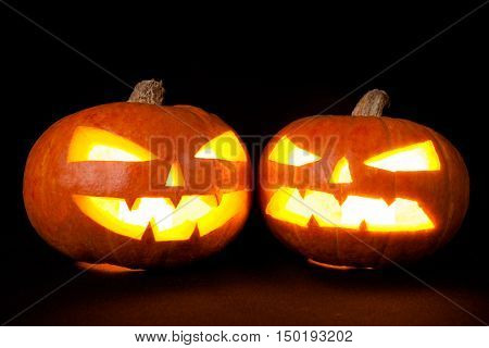 Halloween pumpkins smile and scary eyes for party night. Studio shot