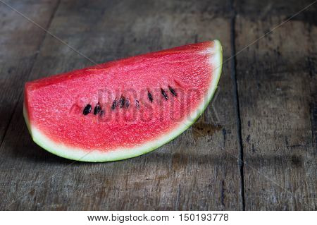 Water melon slice on old wooden table