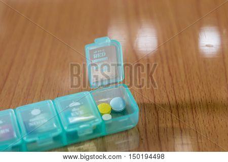 Medicine Dose Box. Prescription Pills In A Blue Pill Box